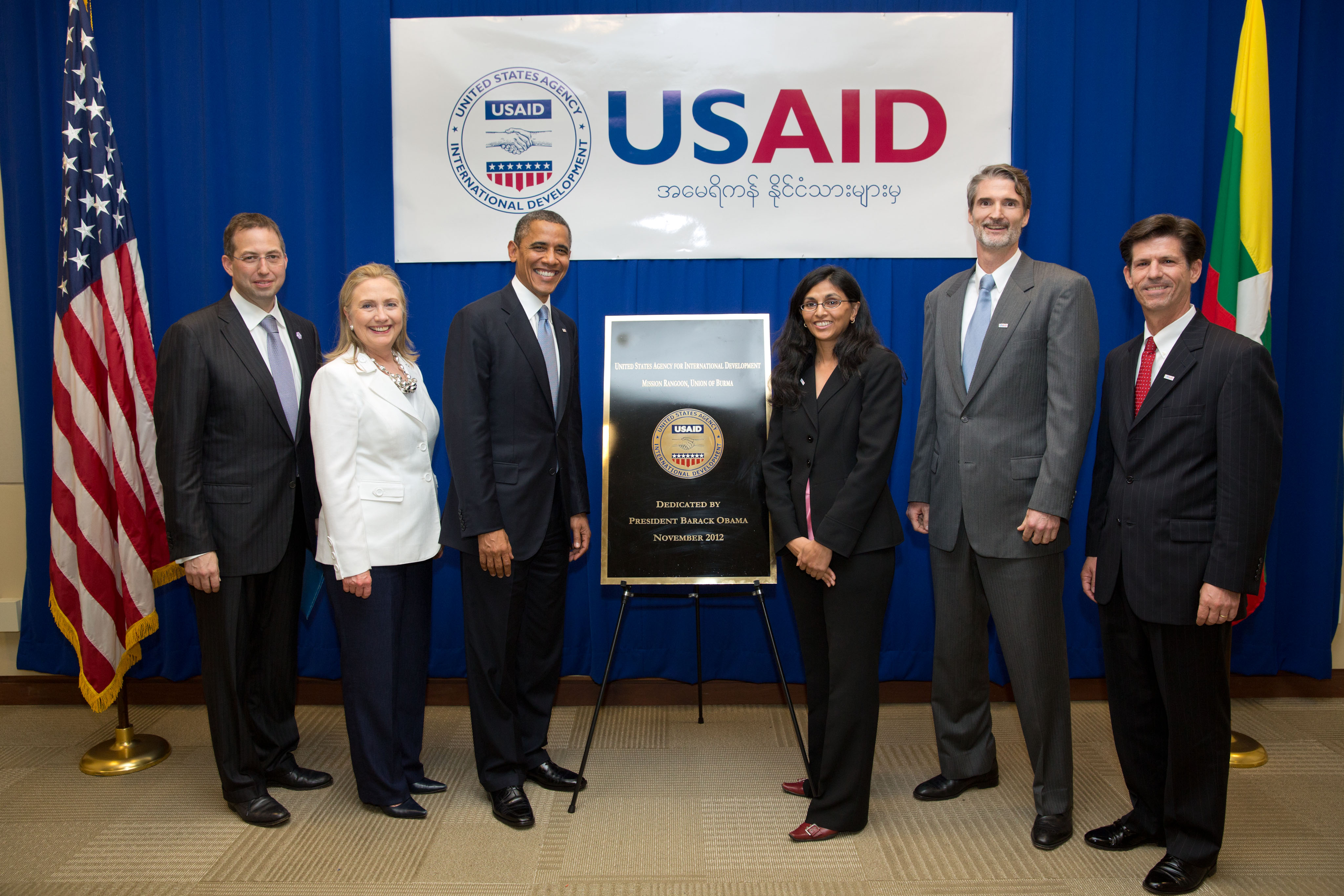 President Barack Obama and Secretary of State Hillary Rodham Clinton pose for a photo with USAID staff at the U.S. Embassy in Rangoon, Burma, Nov. 19, 2012. Participants include: Nisha Biswal, USAID Assistant Administrator for Asia Bureau; Chris Milligan, USAID Burma Mission Director; and Greg Beck, USAID Deputy Assistant Administrator